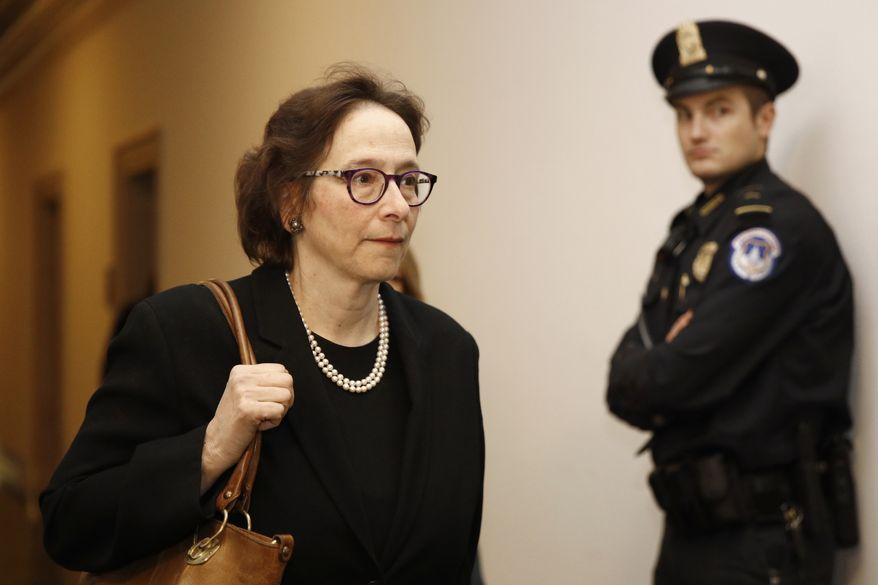 Constitutional law expert, Stanford Law School professor Pamela Karlan, walks to a hearing room during recess to return to testify at a hearing before the House Judiciary Committee on the constitutional grounds for the impeachment of President Donald Trump, on Capitol Hill in Washington, Wednesday, Dec. 4, 2019. (AP Photo/Patrick Semansky)