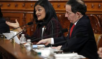 Rep. Pramila Jayapal, D-Wash., questions constitutional scholars during a hearing before the House Judiciary Committee on the constitutional grounds for the impeachment of President Donald Trump, Wednesday, Dec. 4, 2019, on Capitol Hill in Washington. At right is Rep. Jamie Raskin, D-Md. (AP Photo/Jacquelyn Martin)