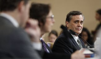 George Washington University Law School professor Jonathan Turley listens to Stanford Law School professor Pamela Karlan testify during a hearing before the House Judiciary Committee on the constitutional grounds for the impeachment of President Donald Trump, on Capitol Hill in Washington, Wednesday, Dec. 4, 2019. Harvard Law School professor Noah Feldman, is left. (AP Photo/Andrew Harnik)