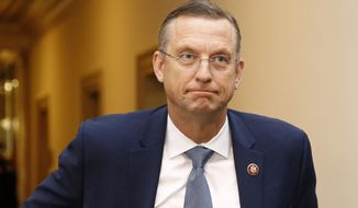 House Judiciary Committee ranking member Rep. Doug Collins, R-Ga., walks to the hearing room during a break in a hearing with Constitutional law experts before the House Judiciary Committee on the constitutional grounds for the impeachment of President Donald Trump. (AP Photo/Patrick Semansky)