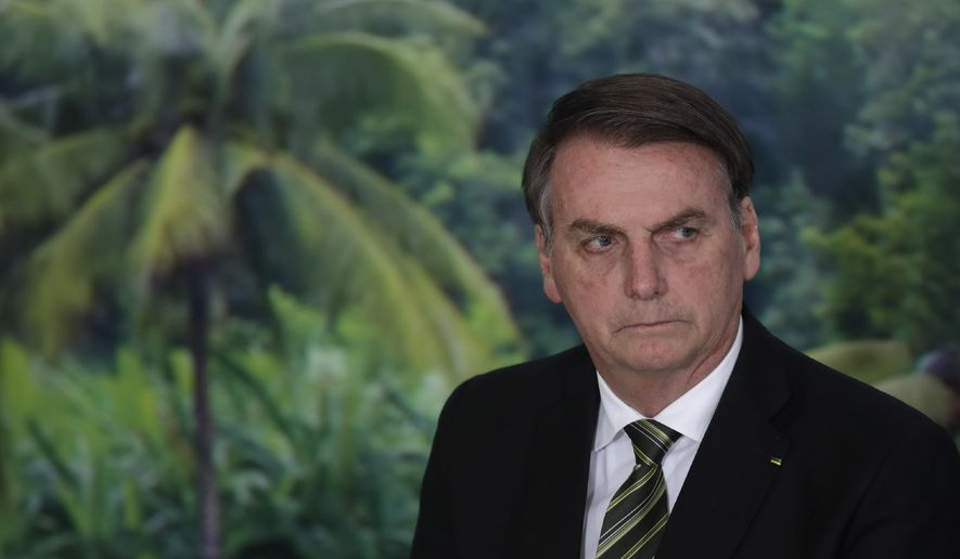 In this Oct. 1, 2019, file photo, President Jair Bolsonaro attends a ceremony to launch an agro program at the Planalto presidential palace in Brasilia, Brazil. (AP Photo/Eraldo Peres, File)