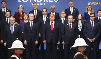 From front row left, British Prime Minister Boris Johnson, NATO Secretary-General Jens Stoltenberg, U.S. President Donald Trump, Turkish President Recep Tayyip Erdogan and Spanish Prime Minister Pedro Sanchez attend a ceremony event during a NATO leaders meeting at The Grove hotel and resort in Watford, Hertfordshire, England, Wednesday, Dec. 4, 2019. NATO Secretary-General Jens Stoltenberg rejected Wednesday French criticism that the military alliance is suffering from brain death, and insisted that the organization is adapting to modern challenges. (AP Photo/Francisco Seco)