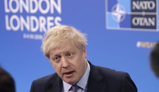 British Prime Minister Boris Johnson arrives for a NATO leaders meeting at The Grove hotel and resort in Watford, Hertfordshire, England, Wednesday, Dec. 4, 2019. As NATO leaders meet and show that the world's biggest security alliance is adapting to modern threats, NATO Secretary-General Jens Stoltenberg is refusing to concede that the future of the 29-member alliance is under a cloud. (AP Photo/Matt Dunham)