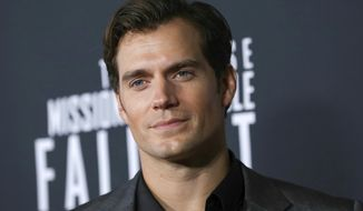 """CORRECTS AUTHOR NAME - FILE - In this July 22, 2018 file photo, actor Henry Cavill attends the U.S. premiere of """"Mission: Impossible - Fallout"""" in Washington. Cavill dons a long white wig to play monster hunter Geralt of Rivia in """"The Witcher,"""" an ambitious eight-episode adaptation of Polish author Andrzej Sapkowski's books. The show premieres on Netflix on Dec. 20. (Photo by Brent N. Clarke/Invision/AP, File)"""
