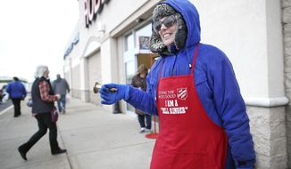 Debi Pulver is all smiles as she rings a bell for the Salvation Army outside of Hobby Lobby in Janesville on Saturday, Nov. 29, 2019. Pulver rings the bell outside the store four or five days a week for four hours at a time.  (Anthony Wahl/The Janesville Gazette via AP)