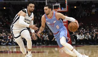 Chicago Bulls guard Zach LaVine (8) is defended by Memphis Grizzlies guard Dillon Brooks (24) during the first half of an NBA basketball game Wednesday, Dec. 4, 2019, in Chicago. (AP Photo/David Banks)