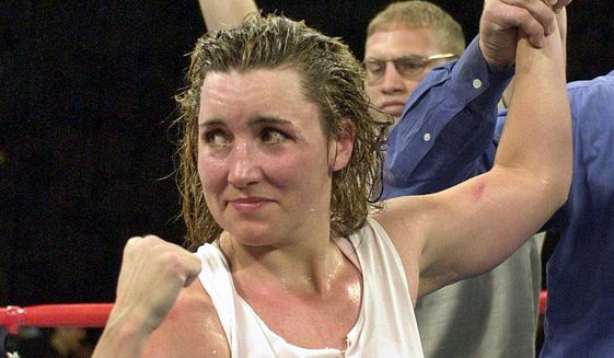 """FILE - In this March 3, 2001, file photo, Christy Martin looks toward her corner following her unanimous 10-round decision over Jeanne """"Boom Boom"""" Martinez, in Las Vegas. Martin was elected to the International Boxing Hall of Fame, Wednesday, Dec. 4, 2019. This was the first year that women were on the ballot. (AP Photo/Kevork Djansezian, File)"""