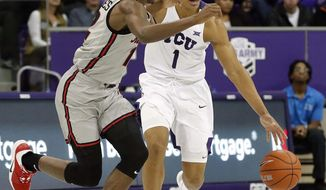 TCU guard Desmond Bane (1) brings the ball up as Illinois State guard Antonio Reeves (12) defends during the second half of an NCAA college basketball game in Fort Worth, Texas, Tuesday, Dec. 3, 2019. (Bob Booth/Star-Telegram via AP)