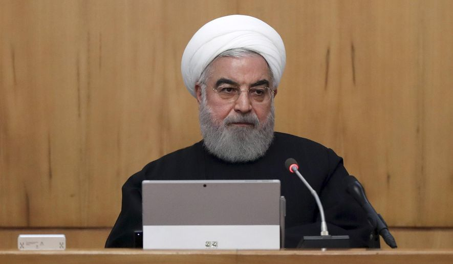In this photo released by the official website of the Office of the Iranian Presidency, President Hassan Rouhani speaks in a cabinet meeting in Tehran, Iran, Wednesday, Nov. 20, 2019. (Office of the Iranian Presidency via AP)