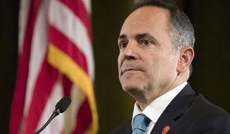In this Oct. 29, 2019, file photo, Republican Matt Bevin looks on during the final Kentucky gubernatorial debate between Bevin, the incumbent, and Democratic candidate Andy Beshear in Highland Heights, Ky. With a few days left in his term as Kentucky's governor, Republican Matt Bevin offered some unsolicited advice to his successor and political rival, urging Democrat Andy Beshear to confront the toughest tasks facing the state the same way he did.  (Albert Cesare/The Cincinnati Enquirer via AP, Pool, Fil)