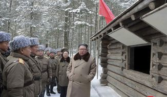 """This undated photo provided on Wednesday, Dec. 4, 2019, by the North Korean government shows North Korean leader Kim Jong Un, right, speaks to lieutenants as he visits Mount Paektu area, North Korea. North Korea says leader Kim has taken a second ride on a white horse to a sacred mountain in less than two months. Independent journalists were not given access to cover the event depicted in this image distributed by the North Korean government. The content of this image is as provided and cannot be independently verified. Korean language watermark on image as provided by source reads: """"KCNA"""" which is the abbreviation for Korean Central News Agency. (Korean Central News Agency/Korea News Service via AP)"""