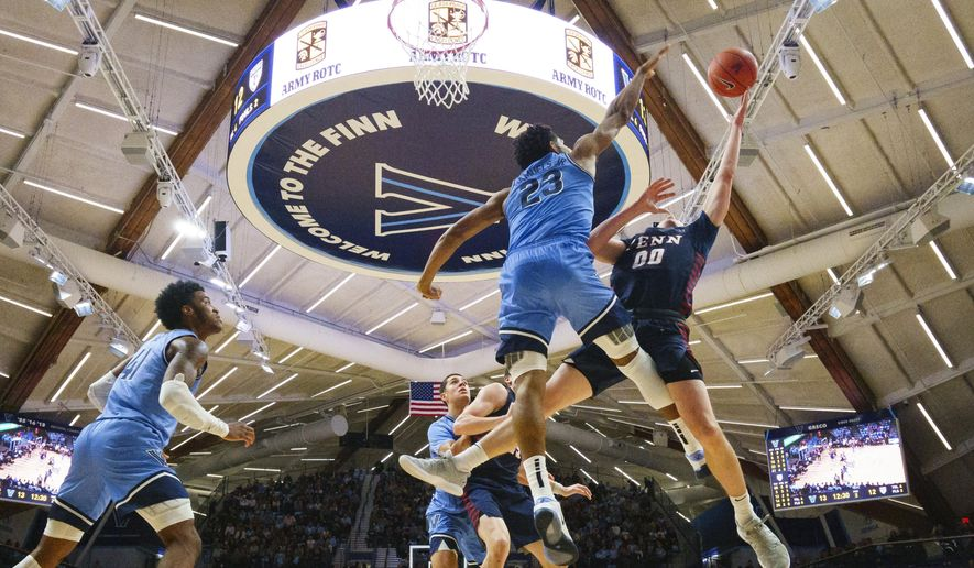 Pennsylvania's Ryan Betley (00) is defended by Villanova's Jermaine Samuels (23) during the first half of an NCAA college basketball game Wednesday, Dec. 4, 2019, in Villanova, Pa. (AP Photo/Matt Slocum)