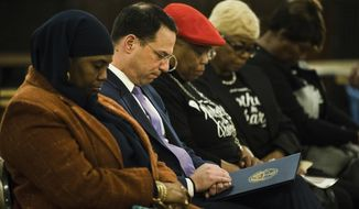 FILE - In this Dec. 14, 2018 file photo, Movita Johnson-Harrell, left, and Pennsylvania Attorney General Josh Shapiro, second left, take part in a vigil for gun violence victims in Philadelphia. Johnson-Harrell, a state House representative from Philadelphia, won a special election in March 2019 and is facing charges after prosecutors accused her of enriching herself by stealing money from a non-profit organization she founded to serve the mentally ill and poor who were fighting addiction. The charges were filed Wednesday, Dec. 4, 2019, by Pennsylvania Attorney General Josh Shapiro's office. (AP Photo/Matt Rourke, File)