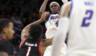 DePaul forward Paul Reed (4) puts up a 3-pointer in front of Texas Tech's Terrence Shannon Jr. during the first half of an NCAA college basketball game in Chicago on Wednesday, Dec. 4, 2019. (Chris Sweda/Chicago Tribune via AP)