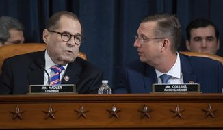 House Judiciary Committee Chairman Rep. Jerrold Nadler, D-N.Y., left, talks with ranking member Rep. Doug Collins, R-Ga., during a hearing before the House Judiciary Committee on the constitutional grounds for the impeachment of President Donald Trump, on Capitol Hill in Washington, Wednesday, Dec. 4, 2019. (Saul Loeb/Pool photo via AP)