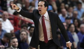 Miami Heat head coach Erik Spoelstra reacts during the second half of an NBA basketball game against the Golden State Warriors, Friday, Nov. 29, 2019, in Miami. (AP Photo/Lynne Sladky)