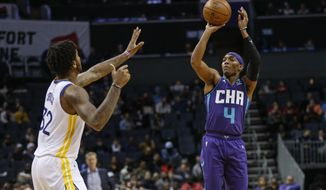 Charlotte Hornets guard Devonte' Graham (4) shoots over Golden State Warriors forward Marquese Chriss during the first half of an NBA basketball game in Charlotte, N.C., Wednesday, Dec. 4, 2019. (AP Photo/Nell Redmond)