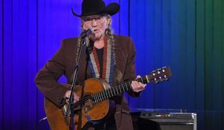 FILE - In this Nov. 13, 2019, file photo, Willie Nelson performs in Nashville, Tenn. Nelson may have given up smoking, but he hasn't stopped using marijuana. While in San Antonio last week for two performances, the 86-year-old country music legend told KSAT TV that in an effort to take better care of himself, he no longer smokes. His spokeswoman, Elaine Shock, told The Associated Press in an email Wednesday, Dec. 4, 2019, that Nelson hasn't given up cannabis, and she points out there are different ways to consume it. (AP Photo/Mark J. Terrill, File)