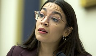 Rep. Alexandria Ocasio-Cortez, D-N.Y., speaks during a House Financial Services Committee hearing on financial stability, on Capitol Hill, Thursday, Dec. 5, 2019, in Washington. (AP Photo/Jose Luis Magana)