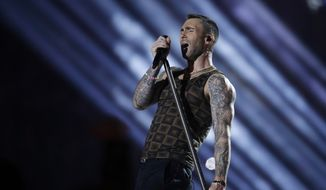 In this Feb. 3, 2019, file photo, Adam Levine of Maroon 5 performs during halftime of the NFL Super Bowl 53 football game between the Los Angeles Rams and the New England Patriots in Atlanta. Maroon 5, Guns 'N Roses, DJ Khaled and DaBaby will perform at the second annual Bud Light Super Bowl Music Fest, to take place Jan. 30 through Feb. 1 at AmericanAirlines Arena in Miami. (AP Photo/Mark Humphrey, File)