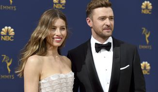 "In this Sept. 17, 2018 file photo Jessica Biel, left, and Justin Timberlake arrive at the 70th Primetime Emmy Awards in Los Angeles. Timberlake has publicly apologized to his actress-wife Jessie Biel weeks after he was seen holding hands with the co-star of his upcoming movie. The pop star and actor wrote on Instagram, Wednesday, Dec. 4, 2019, that he prefers to ""stay away from gossip as much as I can, but for my family I feel it is important to address recent rumors that are hurting the people I love."" (Photo by Jordan Strauss/Invision/AP, File)"