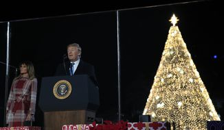 President Donald Trump and first lady Melania Trump attend the National Christmas Tree lighting ceremony at the Ellipse near the White House in Washington, Thursday, Dec. 5, 2019. (AP Photo/Manuel Balce Ceneta)