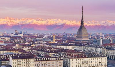 Turin, Italy at sunrise with the Mole Antonelliana towering over the city.
