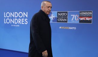 Turkish President Recep Tayyip Erdogan arrives for a NATO leaders meeting at The Grove hotel and resort in Watford, Hertfordshire, England, Wednesday, Dec. 4, 2019. As NATO leaders meet and show that the world's biggest security alliance is adapting to modern threats, NATO Secretary-General Jens Stoltenberg is refusing to concede that the future of the 29-member alliance is under a cloud. (AP Photo/Matt Dunham)