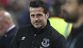 Everton's manager Marco Silva is seen before the English Premier League soccer match between Liverpool and Everton at Anfield Stadium, Liverpool, England, Wednesday, Dec. 4, 2019. (AP Photo/Jon Super)
