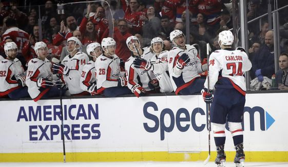 Washington Capitals' John Carlson (74) celebrates his goal with teammates on the bench during the first period of an NHL hockey game against the Los Angeles Kings Wednesday, Dec. 4, 2019, in Los Angeles. (AP Photo/Marcio Jose Sanchez) ** FILE **