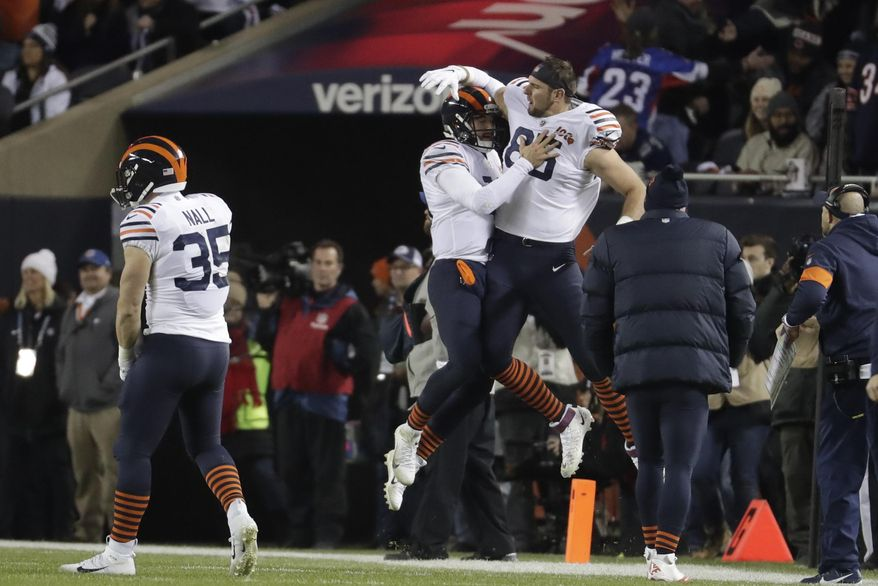 Chicago Bears quarterback Mitchell Trubisky (10) celebrates with Bradley Sowell (85) after Trubisky threw a touchdown pass during the first half of an NFL football game against the Dallas Cowboys, Thursday, Dec. 5, 2019, in Chicago. (AP Photo/Morry Gash)