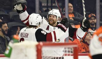 Arizona Coyotes' Phil Kessel, right, celebrates with Clayton Keller after Kessel scored a goal past Philadelphia Flyers goaltender Brian Elliott during the first period of an NHL hockey game, Thursday, Dec. 5, 2019, in Philadelphia. (AP Photo/Derik Hamilton)