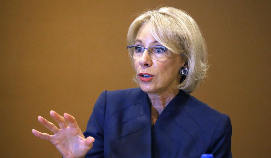 In this file photo, U.S. Education Secretary Betsy DeVos speaks at a roundtable discussion on school choice with Arizona community leaders, educators, parents and students Thursday, Dec. 5, 2019, in Scottsdale, Ariz. (AP Photo/Ross D. Franklin) ** FILE **