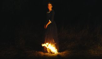 """This image released by Neon shows Adèle Haenel in a scene from """"Portrait of a Lady on Fire."""" (Neon via AP)"""