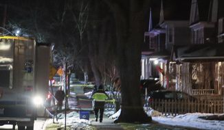 Police investigation the scene after two adults and two children were found dead in their home, Thursday Dec. 5, 2019, shows in Pleasantville, N.Y. Two adults and two children, all members of the same family, were found dead Wednesday in their home in a New York City suburb. (Frank Becerra Jr/The Journal News via AP)