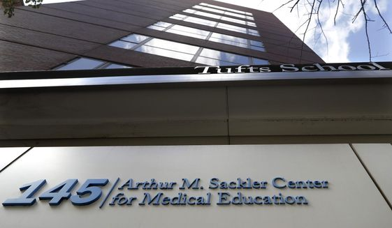 FILE - In this Sept. 25, 2019, file photo, a sign at an entrance to Tufts School of Medicine, in Boston, identifies the address as the Arthur M. Sackler Center for Medical Education. Tufts announced Thursday, Dec. 5, it will strip the Sackler name from all of its institutions. (AP Photo/Steven Senne, File)