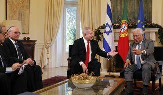 Israeli Prime Minister Benjamin Netanyahu and Portuguese Prime Minister Antonio Costa, right, meet at the Sao Bento palace in Lisbon Thursday, Dec. 5, 2019. (AP Photo/Armando Franca)