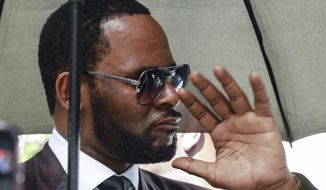 FILE - In this June 26, 2019, file photo, musician R. Kelly departs from the Leighton Criminal Court building after a status hearing in his criminal sexual abuse trial in Chicago. On Wednesday, Dec. 4, 2019, Cook County Judge Lawrence Flood ordered Kelly to stand trial on one of four sexual abuse cases on Sept. 14, but it remains unclear which of the cases prosecutors will take to trial first. (AP Photo/Amr Alfiky, File)