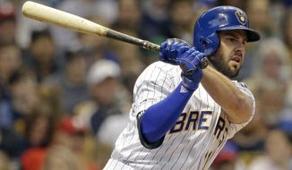 FILE - In this May 24, 2019, file photo, Milwaukee Brewers' Mike Moustakas hits an RBI-double during the first inning of a baseball game against the Philadelphia Phillies, in Milwaukee. The Cincinnati Reds announced signing Moustakas to a four year $64-million contract, Thursday, Dec. 5, 2019. (AP Photo/Aaron Gash, File)
