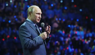 Russian President Vladimir Putin speaks during the International Volunteer Forum at the Olympic Park in Sochi, Russia, Dec. 5, 2019. (Shamil Zhumatov/Pool Photo via AP)
