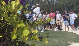 Tiger Woods hits on the par-5 11th hole on his way to an eagle at Albany Golf Club during the second round of the Hero World Challenge in Nassau, Bahamas, Thursday Dec. 5 2019. Woods shot 66. (AP Photo/Doug Ferguson)