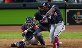In this Oct. 30, 2019, file photo, Washington Nationals' Howie Kendrick hits a two-run home run against the Houston Astros during the seventh inning of Game 7 of the baseball World Series, in Houston. A person with knowledge of the negotiations tells the AP that postseason star Howie Kendrick and the World Series champion Washington Nationals agreed in principle to a one-year contract worth $6.25 million. The person spoke on condition of anonymity because the deal is still pending a successful physical. (AP Photo/Eric Gay) **FILE**