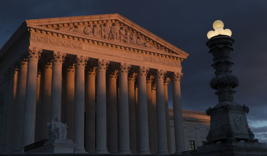 In this Jan. 24, 2019, file photo, the Supreme Court is seen at sunset in Washington. (AP Photo/J. Scott Applewhite, File) **FILE**