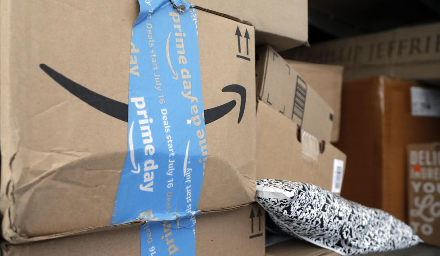 In this July 17, 2018, file photo Amazon Prime packages sit in a delivery truck before being unloaded in Miami. (AP Photo/Lynne Sladky, File)