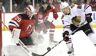Chicago Blackhawks center Ryan Carpenter (22) skates in against New Jersey Devils goaltender Mackenzie Blackwood (29) during the first period of an NHL hockey game Friday, Dec. 6, 2019, in Newark, N.J. (AP Photo/Bill Kostroun)
