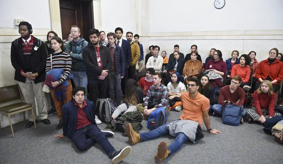 Students from Yale and Harvard University along with members of the Greater New Haven community charged with disorderly conduct after a protest interrupted the annual Yale Harvard football game, wait in Superior Court in New Haven, Connecticut, for their arraignments on Friday, Dec. 6, 2019.  (Arnold Gold/New Haven Register via AP, Pool)