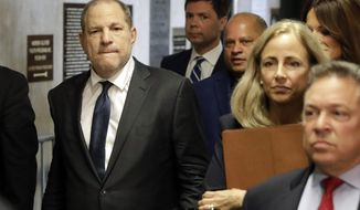 FILE - In this Thursday, July 11, 2019 file photo, Harvey Weinstein, left, arrives at court for a hearing related to his sexual assault case in New York. Harvey Weinstein is scheduled to appear in a New York City courtroom Friday, Dec. 6, 2019 for a pretrial hearing in his rape and sexual assault case. The hearing is one of many courts have scheduled across the state in advance of an overhaul of the state's rules for setting bail for criminal defendants. (AP Photo/Richard Drew, File)