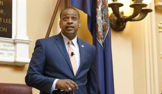 In this Tuesday, July 9, 2019, file photo, Virginia Lt. Gov. Justin Fairfax welcomes visitors at the start of the special session on gun issues at the State Capitol in Richmond, Va. (AP Photo/Steve Helber, File)
