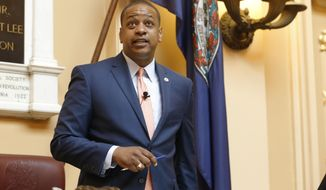 FILE - In this Tuesday July 9, 2019 file photo, Virginia Lt. Gov. Justin Fairfax welcomes visitors at the start of the special session on gun issues at the State Capitol in Richmond, Va. A federal judge is scheduled to hear arguments Friday, Dec. 6, 2019 over whether he should toss out a libel lawsuit filed by Virginia's lieutenant governor. Justin Fairfax sued CBS in federal court in Alexandria after it aired interviews with two women who have accused him of sexual assault.(AP Photo/Steve Helber, File)