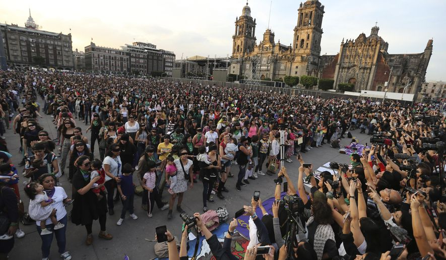 Feminist activists protest at the Zocalo square in Mexico City, Friday, Nov. 29, 2019. According the to the federal government  there were 3,662 gender-related killings of women in Mexico in 2018. (AP Photo / Marco Ugarte)